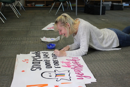 Emma Goad, Editor-In-Chief of Hoofprints, paints signs advertising the new 2017 yearbook that is available for purchase right now. The yearbook was officially finished and submitted for print on May 7th.