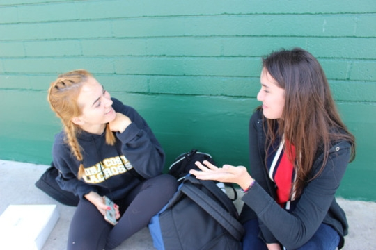 Sophomore Renee Boettner and Kristen Cordero wait during sixth period with their Girls Lacrosse team. Lacrosse finished with their CIF games last week and many sports don't have practice anymore.