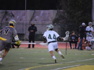 Mira Costa boys lacrosse battles with Peninsula Tuesday night. The Mustangs managed to defeat the Panthers by a final score of 9-2.