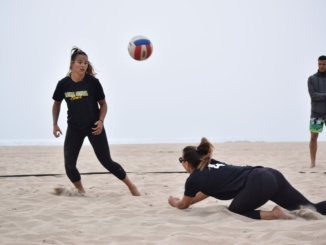 Senior Sunny Villapando looks to receive a ball during a beach volleyball match. Villapando has committed to play collegiate beach volleyball at the University of Stanford next season.
