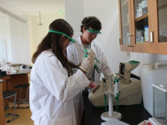 Juniors PJ Sundeen (left) and Zach Horowitz work on pipetting a substance into a PCR machine. The student perform labs in class each day in Biotechnology.