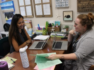 Academic Support Counselor Keshia Fields  (left) and English teacher Maddie Hutchinson (right) review Link Crew applications on Wednesday, Jun. 7 from rising upperclassmen. They selected 97 students to be Link Leaders, who will help freshmen adjust to high school.