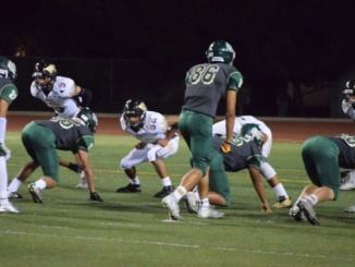 Sophomore Linebacker Cody Kallenbach and the Costa defense prepare to rush in on the opposing offense before a snap. The Mira Costa football team captured an impressive, 35-6, win against West Torrance High School at home on Friday.