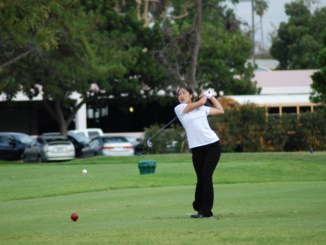 Freshman Juliae Shoda hits an accurate drive that helped contribute to the Mustangs victory. The Mustangs won against Santa Monica High School by a total score of 229-293 on Tuesday.