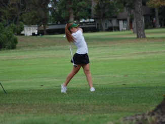 (Above) Junior Maggie Weller takes a swing off the fairway. The Mira Costa Girls Golf team defeated Redondo Union High School, 207-281, at the Alondra Golf Course on Thursday.