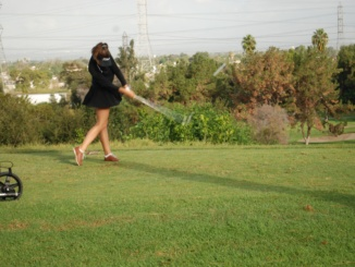 Junior Klara Nagy is pictured above after she carefully putts to the hole. The Mira Costa Girls Golf team defeated North Torrance High School and fell to Palos Verdes High School on Friday.
