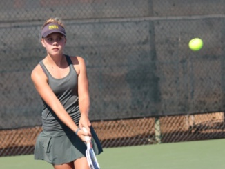 (Middle) Sophomore Hannah Bergen propels the tennis ball to the opposite side of the court. Mira Costa's girls tennis team placed twelfth in the Golden State Tennis Classic at Stanford University on Thursday and Friday