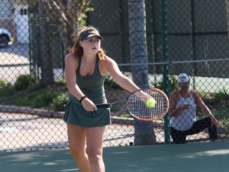 (Middle) Freshman Lucy Fiorito serves the tennis ball. Mira Costa's girls tennis team went 3-0 on their first day of the Beckman Tournament at Beckman High School on Thursday.