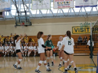 Junior Riley Hazelrieg (middle right) and her teammates rejoice after winning a set. The Mira Costa girls volleyball team placed 7th at the Durango Fall Classic Tournament on Saturday.