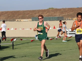 (Left) Junior runner Russell Blakey jogs during the Woodbridge Invitational. The Mira Costa Mustangs competed with 33 other teams.