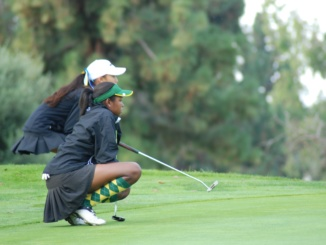 (Front) Sophomore Shani Waite looks at the ball to see where it lands. Mira Costa's Girls Golf team defeated South Torrance High School, 206-246, at Los Verdes Golf Course on Thursday.