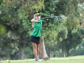 Sophomore Isabella Walker takes a shot off the fairway. The Mira Costa Girls Golf team swept West Torrance High School by a score of 199-223 at Alondra Golf Course on Thursday.