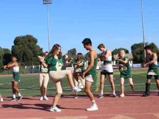 Seniors Breegan Knudson and Chasen Ozawa dance during the pep rally at Waller Stadium today. The Homecoming court choreographed a dance throughout the week and performed it during the rally.