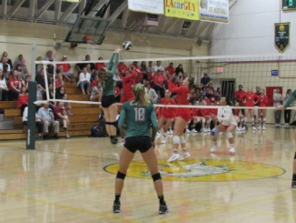 (Middle Left) Junior outside hitter Sami Underwood sets a ball over the net. (This photo was taken at the Costa versus Redondo game last Thursday on Oct. 5th) The Mira Costa girls volleyball team defeated Peninsula 3-0 at an away game on Tuesday.