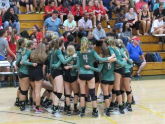 The Mira Costa Girls Volleyball team huddles up between sets. Costa's Girls Volleyball team routed Inglewood, 3-0, at Inglewood High School on Oct. 17.