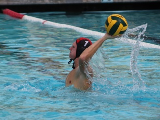 Senior goaltender Paul Matt passes the ball down the pool on Sept. 20 in home game against West Torrance. The Mustangs fell to Foothill, 10-3, at Foothill High School on Friday.
