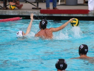(Middle) Attacker Vaughn Compas jumps above the water for a shot on goal. The Mira Costa Water Polo team placed second at the South Bay Tournament at home on Oct. 7.
