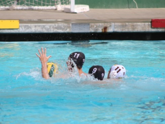 Junior Holden Brown (11 in black) fights to gain possession of the ball for the Mustangs in an earlier match this season. The Mustangs easily defeated Redondo Union on the road Wednesday, winning 6-1.