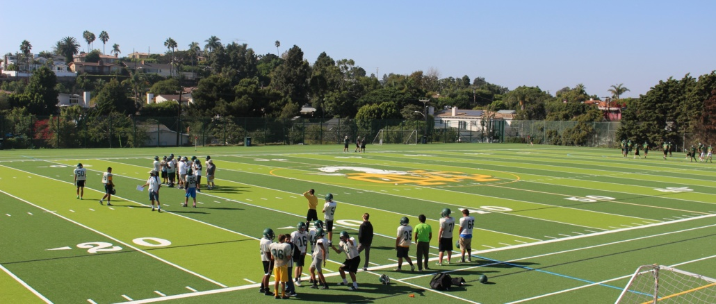 The Mira Costa Junior Varsity Football team practices on the new West Field on Wednesday, which is located on the northwest corner of Costa's campus and on Meadows Avenue. The Costa Associated Student Body planned to have its annual Homecoming Dance on the field, but due to complications including budgeting, they decided to move the event, which will take place tomorrow night in Fisher Gym. (Sarah Toomey/ La Vista)