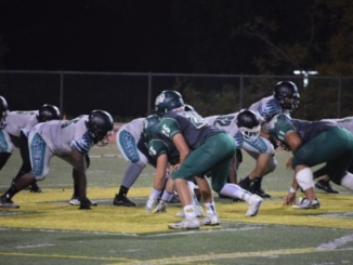 (Middle) Junior defensive lineman Brandon Kelly prepares to rush into the opposing team's offense. The Mira Costa football team was defeated 26-7 versus Palos Verdes at Palos Verdes High School on Friday.