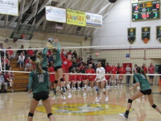In a previous game this year, sophomore Kate Reilly, and junior Memphis Glasgow, block a kill from a Redondo middle blocker. On Halloween, Costa swept  Woodbridge by a score of 3-0.