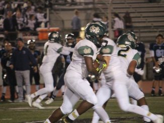 In a previous game this year, senior Vashon Hill runs the ball against an opposing defense. On Saturday, Nov 19, the Mustangs destroyed the Canyon High School Cowboys 45-28 in a CIF Playoff game.