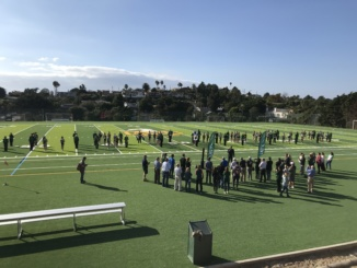 The cheer team and marching band perform before the beginning of the official field opening. The field is now open to the community and all sports.