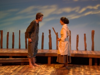 """Sophomore Tucker St. Ivany (left) and senior Ariana Derambaskhsh perform a scene from the Costa Drama Department's play. """"The Diviners,"""" which opened on Nov. 3 in the small theater."""