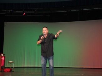 Hispanic speaker Ernie G speaks in the auditorium during an assembly. He spoke about a wide variety of topics that had to do with the school.