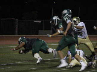(Left) Senior Jonah Tavai runs through the opposing team's defense. The Mira Costa football team advances into the second round of CIF playoffs after defeating Crescenta Valley High School, 13-12.