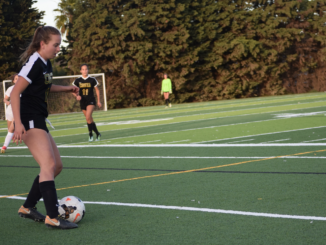 (Left) Junior Kayla Brunick passes the soccer ball. Numerous Mira Costa girls soccer players have been transferring from the school's team to academy teams.