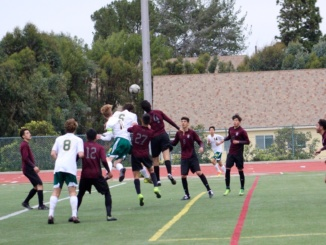 In a game last year, Costa players battle for crossed ball. On Thursday, Costa defeated Culver city in a 5-0 rout.