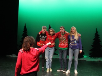 Drama performs their annual holiday benefit and they collect donations to give back.