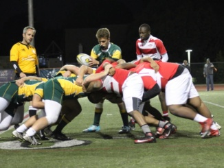 (Middle) Junior Austin Tiradeau prepares to pass the ball. The Mira Costa boys rugby team handily defeated View Park Preparatory High School, 55-0, at home on Jan. 20.