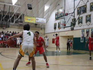 Guard Morgan Clark looks for an opening in the Redondo defense. Mira Costa's varsity basketball team suffered a home loss to the Redondo Union Seahawks at home on Thursday Feb. 8th. The Mustangs fell just short to the Redondo Union Seahawks 63-57.